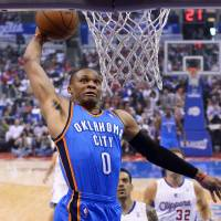 Photo - Oklahoma City Thunder guard Russell Westbrook goes up for a dunk in the first half of Game 4 of the Western Conference semifinal NBA basketball playoff series against the Los Angeles Clippers, Sunday, May 11, 2014, in Los Angeles. (AP Photo/Mark J. Terrill)
