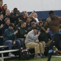 Photo - Pro scouts time Auburn's Dee Ford in the 40-yard dash at pro day for NFL football teams, Tuesday, March 4, 2014, in Auburn, Ala. (AP Photo/Hal Yeager)