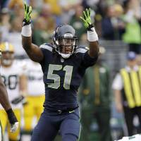 Photo -   Seattle Seahawks defensive end Bruce Irvin celebrates after sacking Green Bay Packers quarterback Aaron Rodgers in the first half of an NFL football game, Monday, Sept. 24, 2012, in Seattle. (AP Photo/Ted S. Warren)