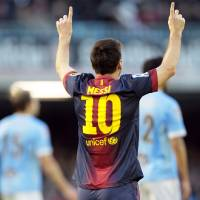 Photo - FC Barcelona's Lionel Messi from Argentina, celebrates after scoring the second goal against RC Celta during a Spanish La Liga soccer match at the Balaidos stadium in Vigo, Spain, Saturday, March 30, 2013. (AP Photo/Lalo R. Villar)