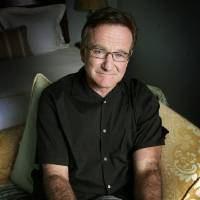 Photo - FILE - This June 15, 2007 file photo shows actor and comedian Robin Williams posing to promote his film,