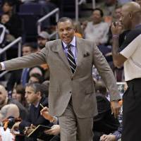 Photo - Phoenix Suns head coach Alvin Gentry, left, complains to referee Haywoode Workman, right, during the first half of an NBA basketball game against the New York Knicks, Wednesday, Dec. 26, 2012, in Phoenix. (AP Photo/Matt York)