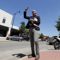Photo -  Urban design expert Daniel Parolek tours Campus Corner on a weeklong study of the Campus Corner and downtown business districts and the residential neighborhoods in between. PHOTO BY STEVE SISNEY, THE OKLAHOMAN   STEVE SISNEY -