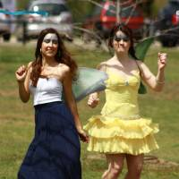 Photo - Dancing fairies Lauren Kelly Lester, left, and Sarah Ex with the Norman Arts Council entertain children at