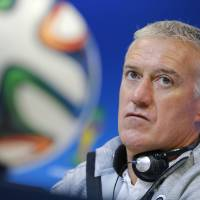 Photo - France's head coach Didier Deschamps attends a press conference, the day before the group E World Cup soccer match between France and Switzerland at the Arena Fonte Nova stadium in Salvador, Brazil, Thursday, June 19, 2014. (AP Photo/David Vincent)