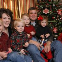 Photo - Rick and Jennifer Payne with quadruplets Preston, Carson, Griffin and Claire and oldest son Parker at their home near Weatherford in 2009.  Photo by David McDaniel, The Oklahoman Archives