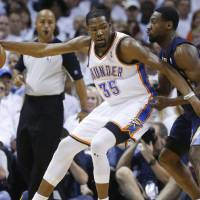 Photo - Oklahoma City Thunder forward Kevin Durant (35) drives against Memphis Grizzlies guard Tony Allen (9) during the first half of Game 5 of an NBA basketball playoffs Western Conference semifinal, in Oklahoma City, Wednesday, May 15, 2013. (AP Photo/Sue Ogrocki)