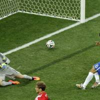 Photo - Brazil's Marcelo, right, scores an own goal past Brazil's goalkeeper Julio Cesar during the group A World Cup soccer match between Brazil and Croatia, the opening game of the tournament, in the Itaquerao Stadium in Sao Paulo, Brazil, Thursday, June 12, 2014. (AP Photo/Thanassis Stavrakis)