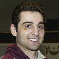 "Photo - FILE - In this Feb. 17, 2010, photo, Tamerlan Tsarnaev smiles after accepting the trophy for winning the 2010 New England Golden Gloves Championship in Lowell, Mass.  Tsarnaev is the Boston Marathon bombing suspect who was killed in a police shootout. His uncle, Ruslan Tsarni, told The Associated Press Friday, May 10, 2013, that the body was buried in Virginia with the help of a ""faith coalition.""  (AP Photo/The Lowell Sun, Julia Malakie, File) MANDATORY CREDIT"