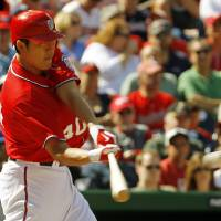Photo -   Washington Nationals' Chien-Ming Wang of Taiwan hits a double off Milwaukee Brewers pitcher Yovani Gallardo during the third inning of a baseball game in Washington, Sunday, Sept. 23, 2012. (AP Photo/Ann Heisenfelt)