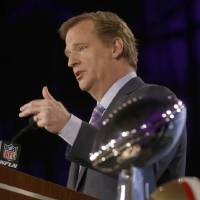 Photo - NFL Commissioner Roger Goodell answers questions during an NFL Super Bowl XLVII football game news conference at the New Orleans Convention Center, Friday, Feb. 1, 2013. in New Orleans. (AP Photo/Gerald Herbert)
