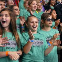 Photo -  Fifth-graders from Horace Mann Elementary School, including Brooklyn Skinner, center, and Marche McEntire, wearing sunglasses, enjoy the sea lion show at Aquaticus. More than 4,000 fourth- and fifth-grade students went to the Oklahoma City Zoo on Thursday to learn about science and the environment through hands-on exhibits and demonstrations. Photo by Jim Beckel, The Oklahoman   Jim Beckel -