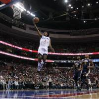 Photo -   Philadelphia 76ers' Nick Young (1) goes up for a shot as Utah Jazz's Jamaal Tinsley (6) and Randy Foye (8) look on during the first half of an NBA basketball game on Friday, Nov. 16, 2012, in Philadelphia. (AP Photo/Matt Slocum)