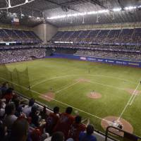Photo - The San Diego Padres and the Texas Rangers play an exhibition baseball game, Saturday, March 30, 2013, at the Alamodome in San Antonio. Texas won 5-2. (AP Photo/Darren Abate)