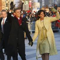 Photo - INAUGURATION / ACTIVITIES: President Barack Obama and first lady Michelle Obama walk the inaugural parade route in Washington, Tuesday, Jan. 20, 2009. (AP Photo/Charles Dharapak) ORG XMIT: DCCD137