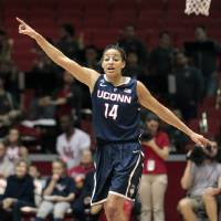 Photo - Connecticut guard Bria Hartley (14) calls out plays after scoring a basket during the first half of an NCCA women's basketball game against Houston, Saturday, Feb. 22, 2014, in Houston. (AP Photo/Patric Schneider)