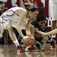 Photo - Oklahoma's Morgan Hook comes up with a loose ball under the Shockers' basket as Michelle Price dives for it in the second half as the University of Oklahoma Sooners (OU) play the Wichita State Shockers in NCAA, women's college basketball at The Lloyd Noble Center on Sunday, Nov. 10, 2013  in Norman, Okla. Photo by Steve Sisney, The Oklahoman