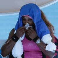 Photo - Serena Williams of the U.S. cools down with ice towel on her shoulders between games during her third round match against Daniela Hantuchova of Slovakia at the Australian Open tennis championship in Melbourne, Australia, Friday, Jan. 17, 2014. (AP Photo/Aaron Favila)