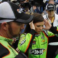 Photo - Danica Patrick, center, prepares to get in her car before the start of the NASCAR Daytona 500 Sprint Cup Series auto race at Daytona International Speedway, Sunday, Feb. 24, 2013, in Daytona Beach, Fla. (AP Photo/Terry Renna)