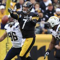 Photo - Pittsburgh Steelers quarterback Ben Roethlisberger (7) loses the ball as he passes under pressure by San Diego Chargers outside linebacker Jarret Johnson (96) and defensive end Kendall Reyes (91) in the first quarter of an NFL football game in Pittsburgh, Sunday, Dec. 9, 2012. (AP Photo/Gene J. Puskar)
