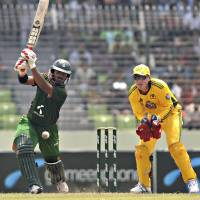 Photo -  Bangladesh batsman Shahriar Nafees plays a shot in front of Australian wicketkeeper Brad Haddin during their second one-day international cricket match in Dhaka, Bangladesh, Monday, April 11, 2011. Australia won the first match of the three-game series on Saturday. (AP Photo/Mir Farid) ORG XMIT: DEL109