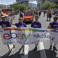 Photo -  Workers carry an eBay banner during the gay pride parade in Salt Lake City. Corporations have increased visibility this summer at gay pride parades as polls show greater public acceptance of gay marriage. AP Photo   Rick Bowmer -  AP