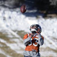 Photo - Denver Broncos wide receiver Wes Welker (83) catches a pass during practice at Dove Valley as they prepare for an NFL football game against the San Diego Chargers in the Divisional Round of the Playoffs on Jan. 6, 2014, in Englewood, Colo.  (AP Photo/The Denver Post, John Leyba) MAGS OUT; TV OUT; INTERNET OUT; NO SALES; NEW YORK POST OUT; NEW YORK DAILY NEWS OUT