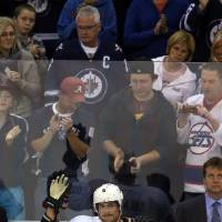 Photo - Anaheim Ducks' Teemu Selanne waves as the fans salute him during the first period against the Winnipeg Jets during NHL hockey action in Winnipeg, Manitoba, Sunday, Oct. 6, 2013. (AP Photo/The Canadian Press, Trevor Hagan)