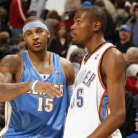 Photo - NBA BASKETBALL: Carmelo Anthony greets Kevin Durant after the game as the Oklahoma City Thunder play the Denver Nuggets at the Ford Center in Oklahoma City, Okla. on Friday, January 2, 2009. Durant scored a go ahead basket with seconds left and Anthony scored a winning three-pointer as time ran out.  Photo by Steve Sisney/The Oklahoman ORG XMIT: kod Photo by Steve Sisney, The Oklahoman