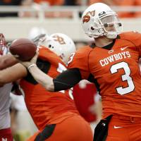 Photo - OSU's Brandon Weeden throws a pass during the college football game between the Oklahoma State Cowboys (OSU) and the Nebraska Huskers (NU) at Boone Pickens Stadium in Stillwater, Okla., Saturday, Oct. 23, 2010. Photo by Bryan Terry, The Oklahoman