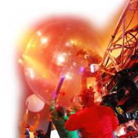 Photo - Wayne Coyne of the band The Flaming Lips crowd surfs in a giant space ball.  ORG XMIT: 0812261519313580