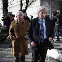 Photo - FILE - In this Jan. 18, 2013 file photo, Mark Strong Sr., right, and his attorney, Dan Lilley, leave the Cumberland County Court House in Portland, Maine. The trial of a key figure in a prostitution scandal at a Zumba studio in Maine has gone through four days without a jury being selected. And it's unclear if the process will resume Monday. The defense is worried that the lengthy delays could cause potential jurors to turn against Strong even before jury selection is completed and the trial begins in earnest. (AP Photo/Robert F. Bukaty, File)
