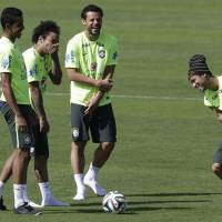 Photo - Brazil's Neymar, right, Fred, second from right, Luiz Gustavo, left, and Marcelo, joke during a training session at the Granja Comary training center in Teresopolis, Brazil, Saturday, June 14, 2014. Brazil plays in group A at the 2014 soccer World Cup. (AP Photo/Andre Penner)