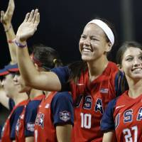 Photo - Team USA's Keilani Ricketts (10), second from right, waves to fans after the championship game of the World Cup of Softball between the United States and Australia at ASA Hall of Fame Stadium in Oklahoma City, Monday, July 2, 2012. The USA won, 3-0. Photo by Nate Billings, The Oklahoman