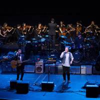 Photo -   This image released by New York University shows the NYU Steinhardt orchestral string ensemble performing with members of the Eagles, foreground from left, Timothy B. Schmit, Glenn Frey, Don Henley and Joe Walsh at the Inaugural Vision Award Gala, Thursday, Nov. 15, 2012 in New York. (AP Photo/New York University, Mathieu Asselin)