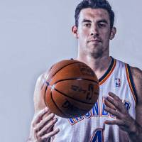 Photo - NBA BASKETBALL: Nick Collison (4) poses for a photo during the Oklahoma City Thunder media day on Friday, Sept. 27, 2013, in Oklahoma City, Okla. Photo by Chris Landsberger, The Oklahoman