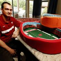 Photo -  Kevin Kruger shows pet beds Thursday in Norman that he designed and sells that look like college football stadiums. Photo by Steve Sisney, The Oklahoman   STEVE SISNEY -