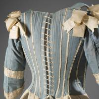 Photo - This image released by The Museum at FIT shows a 1770s European corset in silk.  From a 1770 corset to a 2014 bra-and-panty set in lacy stretch silk, the Museum at the Fashion Institute of Technology has taken on lingerie and ladies foundation garments as the focus of a new exhibition. In about 70 pieces,