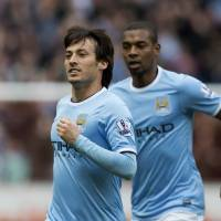 Photo - Manchester City's David Silva celebrates after scoring against Hull City during their English Premier League soccer match at the KC Stadium, Hull, England, Saturday March 15, 2014. (AP Photo/Jon Super)