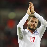 Photo -  FILE This Wednesday, Oct. 14, 2009 file photo shows England's David Beckham applauding the crowd after their World Cup group 6 qualifying soccer match against Belarus at Wembley Stadium, London. Former England captain David Beckham has failed to make the British football team for the London Olympics. The Los Angeles Galaxy midfielder made Britain coach Stuart Pearce's shortlist of 35 but wasn't selected for the final 18-man squad as one of three players over the age of 23 allowed to compete in the games.