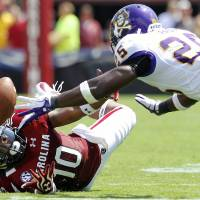 Photo -   South Carolina wide receiver Nick Jones, left, and East Carolina defensive back Leonard Paulk, right, dive for a pass from South Carolina quarterback Dylan Thompson during first half of their NCAA college football game in Columbia, S.C., Saturday, Sept. 8, 2012. (AP Photo/Brett Flashnick)