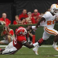 Photo -   Tennessee running back Rajion Neal (20) is dragged down by Georgia linebacker Amarlo Herrera (52) during the first half of an NCAA college football game in Athens, Ga., Saturday, Sept. 29, 2012. (AP Photo/John Bazemore)