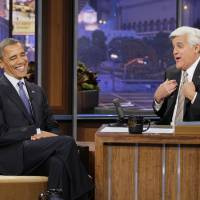 Photo - This Oct. 12, 2012 photo released by NBC shows President Barack Obama  during an interview with host Jay Leno on NBC's