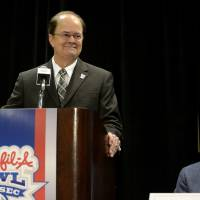 Photo - Duke head coach David Cutcliffe, left, smiles next to former coach Bill Curry as Cutcliffe accepts the Bobby Dodd Coach of the Year on Monday, Dec. 30, 2013, in Atlanta. Cutcliffe, who led Duke to its first 10-win season and a spot in the ACC championship game, will face Texas A&M in the Chick-fil-A Bowl on Tuesday night. (AP Photo/David Tulis)