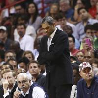 Photo - Detroit Pistons head coach Maurice Cheeks watches game action against the Miami Heat during the second half of an NBA basketball game in Miami, Monday, Feb. 3, 2014. The Heat won 102-96. (AP Photo/J Pat Carter)