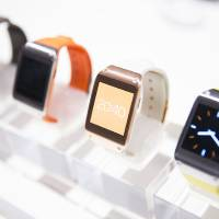 Photo - New Samsung Galaxy Gear in different colors are on display after the presentation in Berlin on Sept. 4. (AP Photo/Gero Breloer)  Gero Breloer
