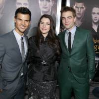 Photo - From left, Taylor Lautner, Stephenie Meyer, and Robert Pattinson attend the world premiere of