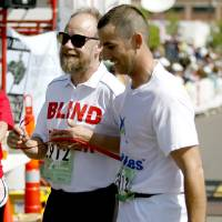 Photo - Blind runner Kerry Cook walks with his guide Matt Guidry after finishing the Oklahoma City Memorial Marathon, Sunday, April 27, 2008.  BY BRYAN TERRY, THE OKLAHOMAN ORG XMIT: KOD