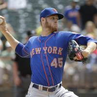 Photo - New York Mets starting pitcher Zack Wheeler throws in the first inning of their interleague baseball game against the Oakland Athletics Wednesday, Aug. 20, 2014, in Oakland, Calif. (AP Photo/Eric Risberg)
