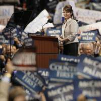 Photo - GOP: Republican vice presidential candidate Sarah Palin gets ready to address the Republican National Convention in St. Paul, Minn., Wednesday, Sept. 3, 2008.  (AP Photo/Charlie Neibergall) ORG XMIT: MNDC158